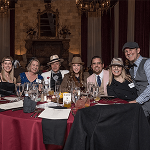 Philadelphia Murder Mystery party guests at the table