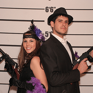 Philadelphia Murder Mystery party guests pose for mugshots